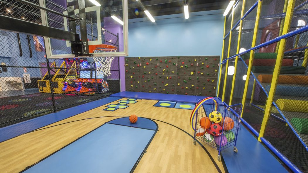 Indoor basketball court and climbing wall inside Kids Quest at Northern Quest.